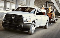 Dodge RAM 3500 towing a tractor