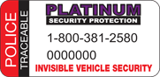 Visible warning decals on the driver and front passenger windows identify the vehicle as being registered with a national theft prevention company. These decals warn thieves that the vehicle's key components are marked.