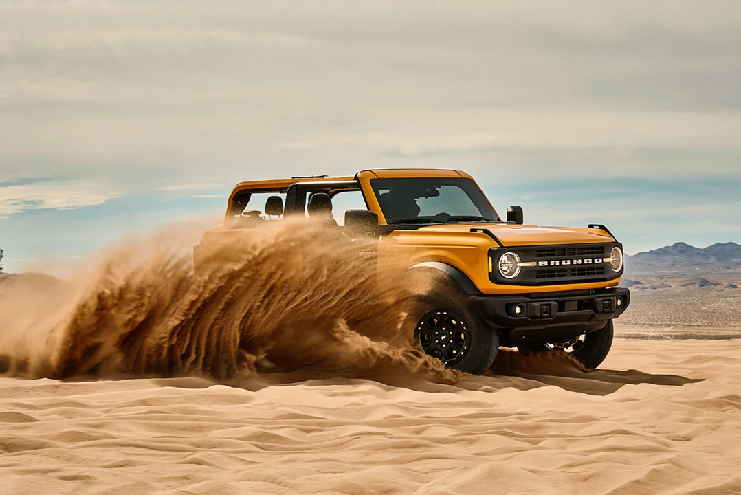 2021 Ford Bronco - Yellow Exterior driving in the sand